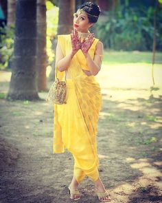"Ethnic Indian wear meets contemporary fashion with ""Dhoti Saree""  #PreciosaCollection#dhoti#dhotisaree#smthingunique#classy&fashionable#perfectattire4mehndi#cocktail#comfy2carry#fusionwear#yellowdhotisaree#yellow&gold#mamostfavcombi#indianwedding#goldjewellery#completeslook#stylishme...."