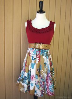 Men's tank, re-purposed with ruffles on the top and an old dress bottom sewn on for the skirt...would be awesome using a Goodwill dress for the bottom.  In fact, now that I think of it, any Goodwill dress could become a boho skirt this way!