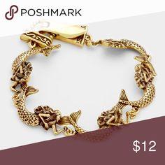 "Metal mermaid link magnetic bracelet • Color : Gold Burnished • Theme : Mermaid, Sea Life  • Size : 0.7"" H, 8"" L • Magnetic closure Jewelry Bracelets"