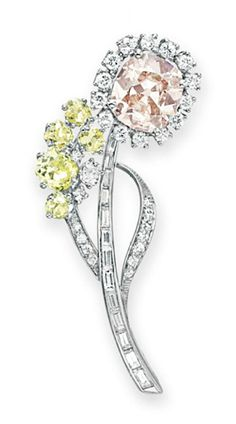 A COLORED DIAMOND AND DIAMOND BROOCH, BY OSCAR HEYMAN & BROTHERS.   Designed as a flower, set with a cushion-cut fancy brown-pink diamond, weighing approximately 3.60 carats, with circular-cut diamond petals and leaves, accented by a cluster of old mine-cut diamond buds, to the baguette-cut diamond stem, mounted in platinum. With maker's mark for Oscar Heyman & Brothers.