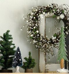 love this.  The natural + jingle bell wreath, the mini trees.