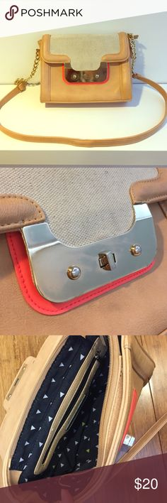 Cross body purse Cross body w/ adjustable strap • faux leather and canvas • beige with gold and bright coral accent • plenty of pockets with outer pocket • great condition! Francesca's Collections Bags Crossbody Bags