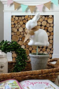 Target Dollar Spot bunny made into topiary in front of faux fireplace with stacked wood-www.goldenboysandme.com