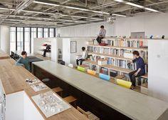 Nikken Sekkei's interior design office has a bookshelf staircase