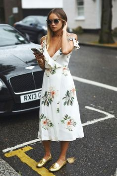 Nina has us coveting a cold-shoulder floral print dress to wear for the rest of the summer. Pair it with metallic gold loafers and you've instantly got yourself a feminine, yet edgy look!