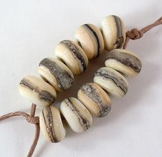 Silvered Ivory on Ivory - Lampwork Accent Beads - Etched. $11.00, via Etsy.