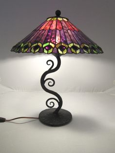 tiffany style decorative purple leaded glass waves of light wrought iron table lamp C23 by Bushereironstudio on Etsy https://www.etsy.com/listing/232922396/tiffany-style-decorative-purple-leaded