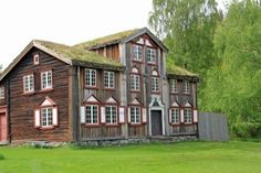 Old Norwegian Farmhouse. I love the living roof and window trim!