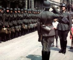Wehrmacht inspection at Paris, France, in 1941, possibly before going to the Eastern Front. Please note the standard issue M31 Clothing bag and kids roaming freely!