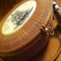 Vintage Nantucket Basket with bone scrimshaw pendant depicting a tall sailing ship. From Skipjack Nautical Wares & Marine Art Gallery. Nantucket Style, Nantucket Island, Marthas Vinyard, Nantucket Baskets, Old Baskets, New England Style, Market Baskets, Blue Hydrangea, Wicker