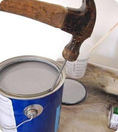 Clavar un clavo a través del borde interior de sus latas de pintura, y la pintura se vaciará de nuevo en la lata.