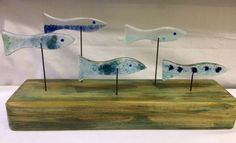 Shoal of five fish - recycled fused glass on a driftwood base by KateOsmanGlass on Etsy https://www.etsy.com/uk/listing/484555430/shoal-of-five-fish-recycled-fused-glass