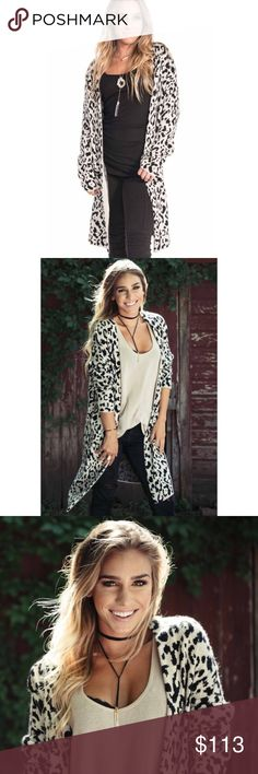 "Black & White Leopard Print Duster Cardigan If you're looking to jump on the animal print trend but want to stay on the conservative side, this midweight, tight-knit cardigan with a soft mohair look is a great option for you! No crazy colors, your classic black and white. Unlike your heavy, chunky sweaters, this one can be worn year-round. Best part? It has pockets 😍  - Model is 5'4"" and wearing size Small. Sadie Coleman Sweaters Cardigans"
