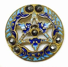 Antique blue openwork six pointed champleve enamel button with cut steel rivets.
