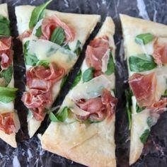 white pizza with prosciutto and arugula.