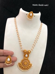 Temple Jewellery available at Ankh Jewels for booking WhatsApp on Pearl Necklace Designs, Pearl Jewelry, Gold Jewelry, Gold Bangles Design, Gold Jewellery Design, Indian Jewelry Sets, Bridal Jewelry Sets, Terracota Jewellery, Temple Jewellery