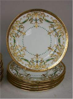 SET OF FIVE MINTON GILT DECORATED DINNER PLATES, retailed by Smith Patterson, Boston, diameter: 10 1/4 inches; together with FOUR WORCESTER DINNER PLATES, diameter: 10 3/4 inches