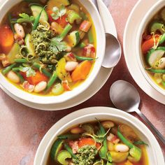 """This classic French soup is traditionally finished with a dollop of pistou, a nut-free version of pesto, though leftover or store-bought refrigerated pesto is also delicious here. Don't rinse the canned beans after draining; any remaining starches will help bring the soup together. To save time, look for prechopped onion, celery, and carrot in the produce section. You could also use any vegetables or herbs you have on hand, making this a great """"use it up"""" option for clearing out produce at…"""