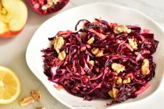 Red cabbage apple slaw with pomegranate and walnuts. Quick, simple, crunchy, sweet and sour salad. It's delicious and looks really lovely on the table. Apple Slaw, Best Salad Recipes, Walnut Salad, Red Cabbage, Chicken Salad, Pomegranate, Seafood, Vegetarian, Vegetables