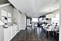 A quality home builder with 35 years of experience through our parent company Shane Homes. Visit our new communities, showhomes, new homes, quick possession homes and more. Floor Layout, New Community, Home Builders, Kitchens, New Homes, Flooring, Building, Table, Furniture
