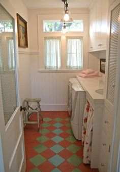 beadboard, encaustic tiles, and an under-counter skirt in a farmhouse laundry room