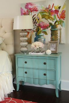 love the turquoise chest as a night stand and the colorful painting