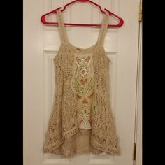 "🎊HP 3/16🎊Free People Maya Yarn Tank This tank is beige with a beautiful design. It has an inner, frayed lining. The front has a design with salmon, green and white sequins with brown stitches. It has been worn once and is like new. It is approximately 17"" across the bust when laid flat. It is approximately 24"" from shoulder to hem at its shortest and 31"" at its longest. The shell is 66% cotton, 34% acrylic. The lining is 54% polyester, 46% cotton. The decoration is 75% polyester, 25%…"