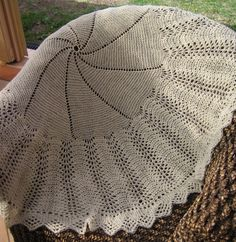 Free Knitting Pattern for Bubbles Circular Baby Blanket or Shawl - Updated version based on a vintage Patons design of lace blanket with a spiral eyelet center. Pictured project by Judith2143