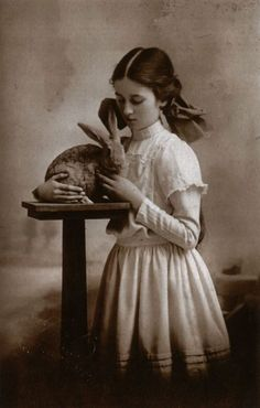 "Girl cuddling rabbit, circa 1909  From ""Beauty and the Beast: Human-Animal Relations as Revealed in Real Photo Postcards, 1905-1935"""