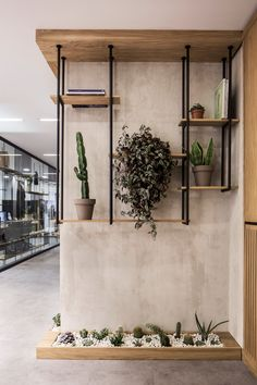 Elissa Stampa Fashion Design Office - Green area-The entrance welcomes the visitors with a small waiting area that is enhanced by the usage of green shelves where the organic and natural attitude of t. Bureau Design, Office Interior Design, Office Interiors, Office Wall Design, Small Office Design, Office Designs, Design Interiors, Green Shelves, Deco Restaurant