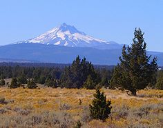 Bend, Oregon.  My uncle had a house in the high desert of central Oregon.  He built a hot tub in a tower with a view of 6 mountains. When I was a teen we would get up early to watch the sunrise from the hot tub and later the sunset.