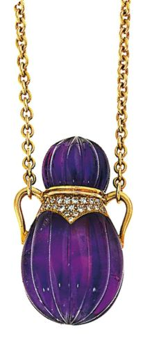 An amethyst and diamond pendant Designed as a reeded amethyst amphora with brilliant-cut diamond detail to the front, to a cable-link chain, pendant 4.0 cm long, chain 73.0 cm long