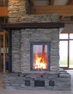 masonry heater, love the more modern smaller rocks