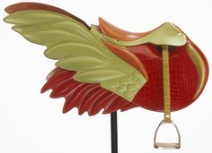 Saddle with wings