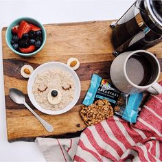 """""""Oats with blueberries and almonds before school; in a bowl for little miss, in a @kindsnacks bar for me."""" -@howaboutcookie"""