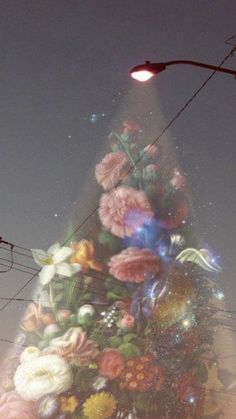 Street lamp lighting up the street with boquets and flowers. If only this was real!
