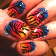 fun nail design! easy too: start with blue near the base of the nail, then overlap it with pink  overlap the pink with yellow, ending at the tip of the nail. use a thin brush to create zebra lines. enjoy:)