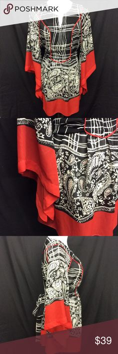 """SUNNY LEIGH WOMAN Red/Wht/Blk Top Plus Size 1X This absolutely beautiful, black, white, and red pullover chiffon top is done in an abstract and paisley print. The assymetrical, kimona style sleeve has a 6"""" red border, and is 4"""" wide on the bottom. V-front, wide attached sash, yoke neckline. 100% polyester, machine wash, tumble dry. No pockets or shoulder pads. Length 33"""", shoulder 19"""", chest 50"""", a-line down to 62"""". This is slightly sheer, so best to wear a tank top or camisole underneath…"""