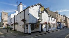 Sun Inn Kirkby Lonsdale In the heart of the beautiful market town of Kirkby Lonsdale overlooking St Mary's Church, this 17th century inn fuses both traditional and contemporary elements.  The traditional bar has a log fire and serves award-winning, local cask and keg beers.