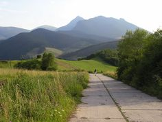 In the foreground road to Plešivá built in . In the background peak Rozsutec Sidewalk, Country Roads, Mountains, Building, Places, Pray, Side Walkway, Buildings, Sidewalks