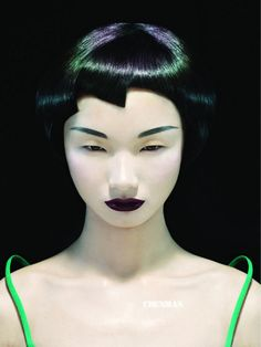 The hair is gorgeous. Black with brilliant areas of purple and green color, and very cyber-noir makeup.