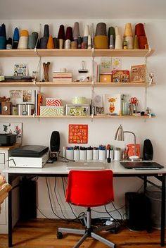 Desk, pencil holders, lamp, shelves