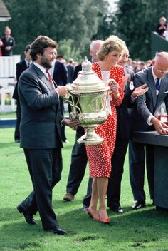 Diana Princess of Wales and Alain Dominique Perrin hold the trophy during the Finals Day of The Cartier Queen's Cup to present the Cup to the winning patron at the Guard's Polo Club on July 28, 1988 in Windsor, England.