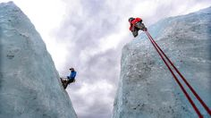 After completing their attempt to reach the top, Dan and Caren look deep into the 200-foot crevice on Godwin Glacier.