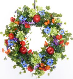 Apple, Cosmos & Ranunculus Spring Wreath (Silk) This gorgeous designer silk wreath starts off with a grapevine base and incorporates gold cosmos, red apples, blue cosmos, green hydrangea, red ranunculus, berries, and ivy to make this wreath perfect for year round display.