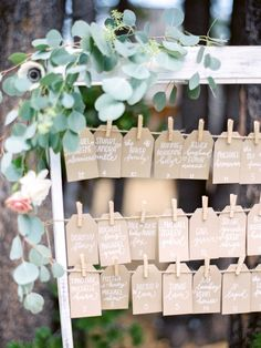 Clothespin hung escort cards: http://www.stylemepretty.com/california-weddings/lake-tahoe-ca/2016/02/01/whimsical-al-fresco-lake-tahoe-wedding-at-the-hideout-inn/   Photography: Coco Tran - http://www.cocotran.com/