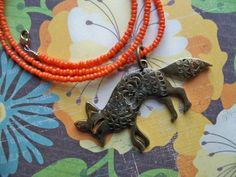 BRONZE FOX PENDANT on Orange 20 Inch Seed Bead Necklace by artbycandice on Etsy https://www.etsy.com/listing/170155941/bronze-fox-pendant-on-orange-20-inch
