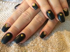 Matte black negative space nails with gold studs