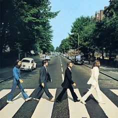 "The Beatles, Abby Road ~ part of the ""Paul McCartney is dead"" rumour in 1969 is due to this album cover, where John is dressed as a jesus, Ringo a mortician, George as a gravedigger and Paul as a corpse (in a suit, but barefoot)."