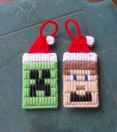 "Set of 2 Minecraft inspired Christmas ornaments. Creeper and Steve. Made from plastic canvas and yarn. Measures approx 2"" across and almost 4"" from top of hat to bottom. These will be great hanging on the tree of a Minecraft fan!"